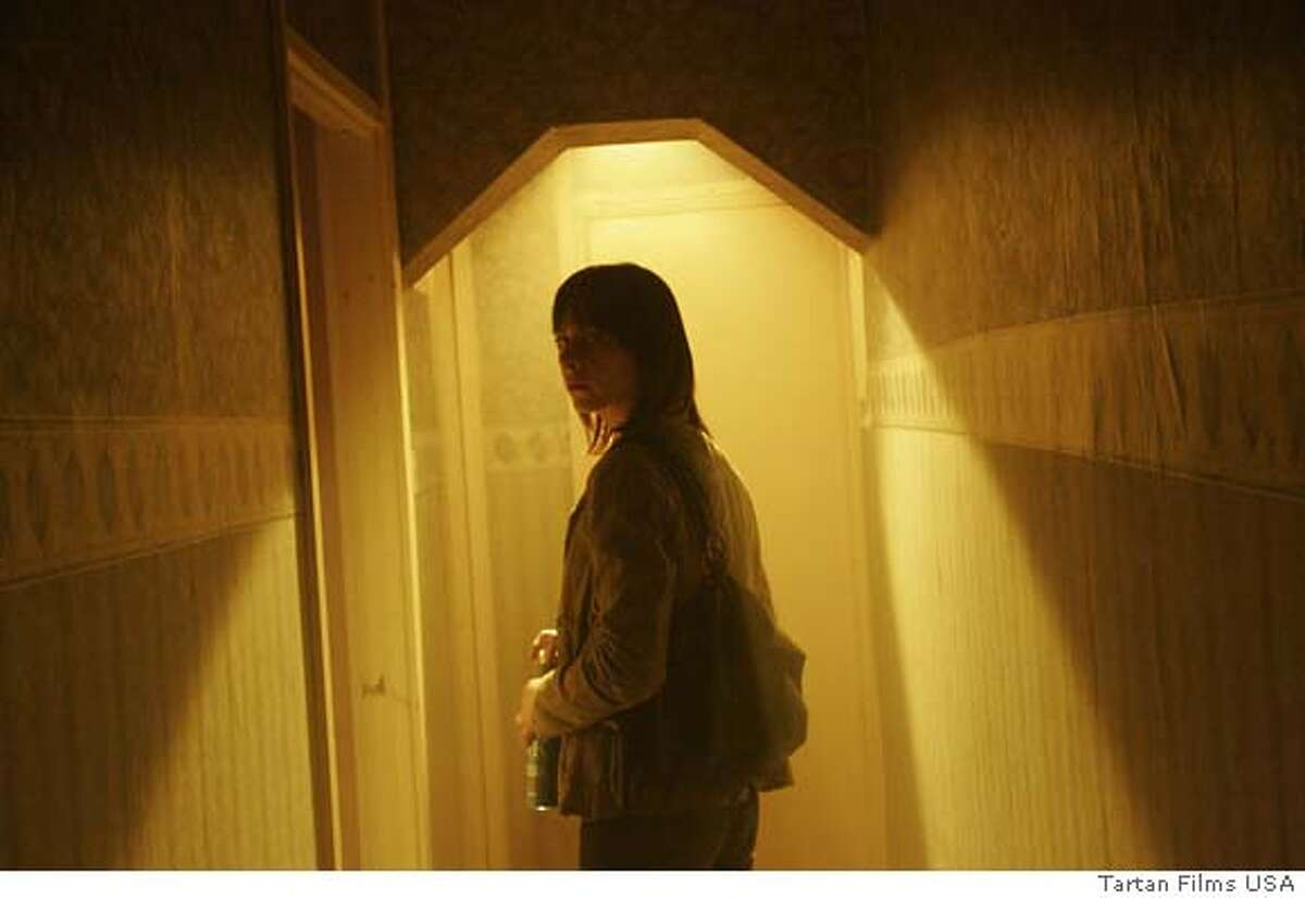 Kate Dickie plays Jackie, a security surveillance operator for the city of Glasgow who is confronted with a man from her past in Andrea Arnold's dramatic thriller,
