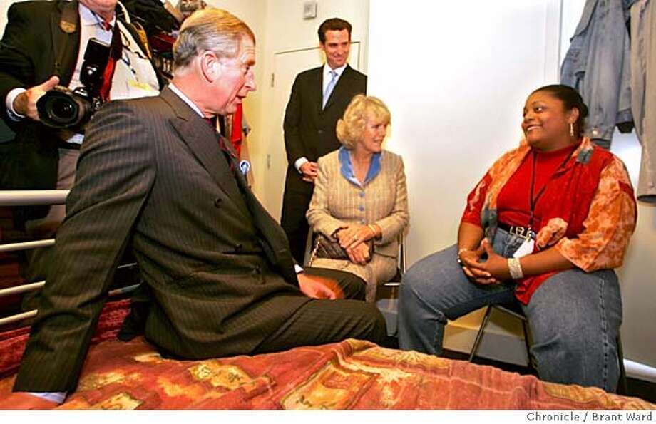 Prince Charles sits on the bed of formerly homeless person Renee McIntyre, 48. They had a discussion about homelessness in America...in background is his wife Camilla and San Francisco mayor Gavin Newsom.  Prince Charles and his wife, Camilla, Duchess of Cornwall, visit the Empress Hotel in San Francisco Tuesday morning. The Empress Hotel houses chronically homeless people...many of which have spent years on the street.There are 90 residents who get supportive housing, on-site medical and psychiatric services.  11/8/05 Photo: Brant Ward