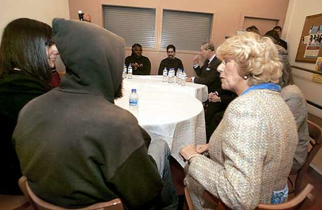 Aboud Naoun, left in hooded shirt, talks with Camilla, Duchess of Cornwall, about the homeless situation in San Francisco. Prince Charles is in background. The royal couple had a chance to talk with residents of the Empress Hotel.  Prince Charles and his wife, Camilla, Duchess of Cornwall, visit the Empress Hotel in San Francisco Tuesday morning. The Empress Hotel houses chronically homeless people...many of which have spent years on the street.There are 90 residents who get supportive housing, on-site medical and psychiatric services.  11/8/05 Photo: Brant Ward