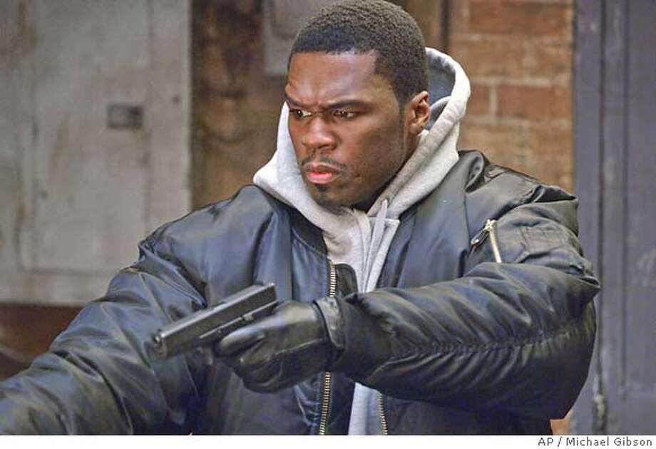 "In this photo provided by Paramount Pictures, Curtis ""50 Cent"" Jackson, one of the most popular stars in hip-hop, makes his motion picture debut as an orphaned street kid who makes his mark in the drug trade but finally dares to leave the violence behind and become the rap artist he was meant to be in Get Rich or Die Tryin',"" the new film from six-time Oscar nominee Jim Sheridan. (AP Photo/Michael Gibson) Photo: MICHAEL GIBSON"