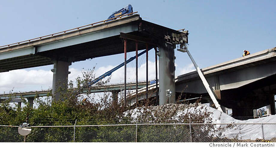 The collapsed portion of the 580 highway seen from a waste water treatment facility in Oakland. Caltrans workers inspect freeway, PHOTO: Mark Costantini / The Chronicle Photo: MARK COSTANTINI