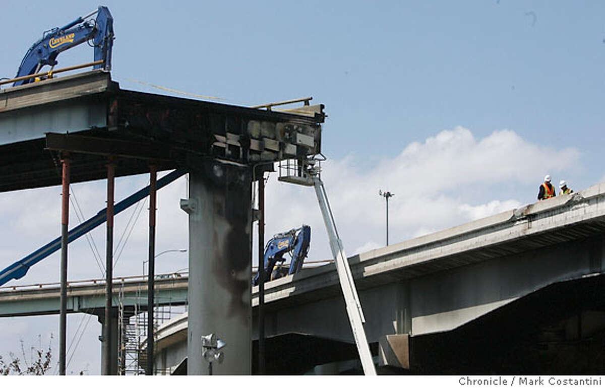 The collapsed portion of the 580 highway seen from a waste water treatment facility in Oakland. Caltrans workers inspect freeway, PHOTO: Mark Costantini / The Chronicle