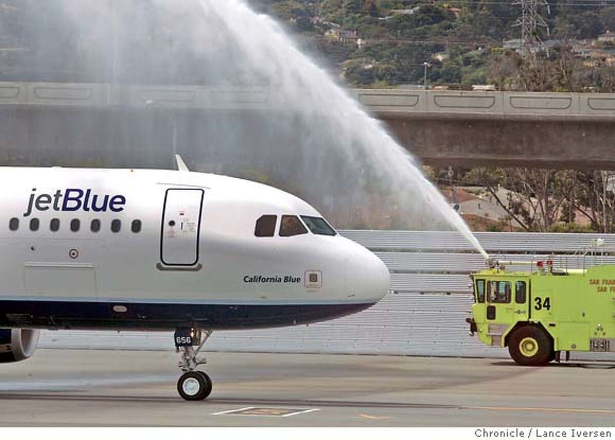 JetBlue Airways inaugural flight between New York's JFK and San Francisco International gets a water canon greeting as it arrived at the International Terminal at SFO gate A10 Thursday, May 3, 2007.