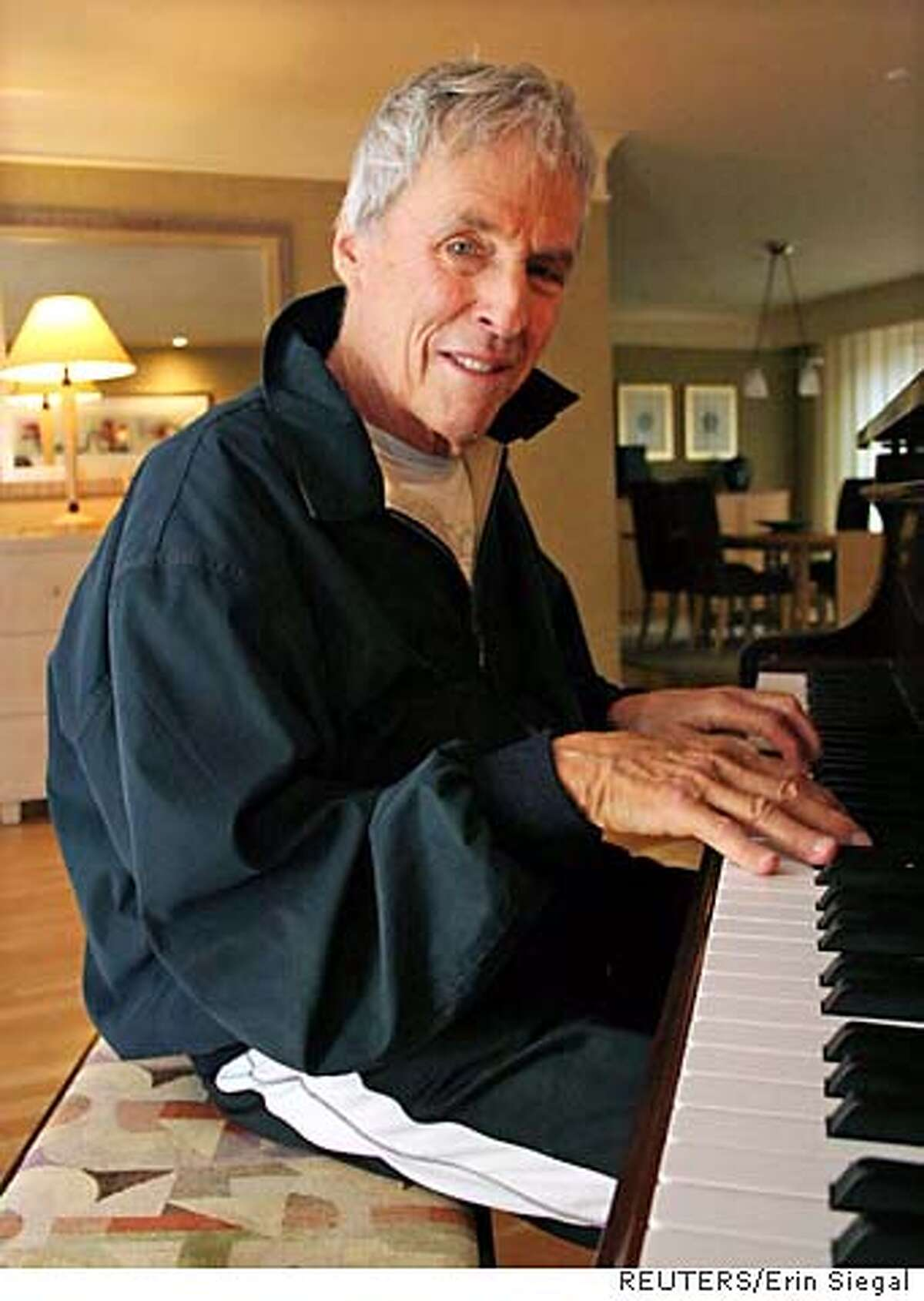 """Burt Bacharach, winner of three Oscars and six Grammys, is seen in his hotel room in New York October 10, 2005. The legendary, 77-year-old composer has found his voice in a politically charged album """"At This Time"""" that features his first lyrics ever in a nearly 50-year career creating some of pop music's best-known love songs. Picture taken October 10, 2005. To accompany feature LEISURE BACHARACH. REUTERS/Erin Siegal 0"""