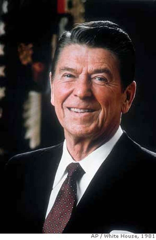 **FILE** U.S. President Ronald Reagan poses for an official White House photo in Washington D.C., in this 1981 file photo, during his first year in office. Reagan, the cheerful crusader who devoted his presidency to winning the Cold War, trying to scale back government and making people believe it was ``morning again in America,'' died Saturday, June 5, 2004, after a long twilight struggle with Alzheimer's disease. He was 93. (AP Photo/White House, File) Ran on: 06-20-2004  President Reagan had a vision of America as &quo;The Shining City upon a Hill.'' Ran on: 06-20-2004 Ran on: 07-17-2005 1981 FILE PHOTO NO SALES Photo: White House
