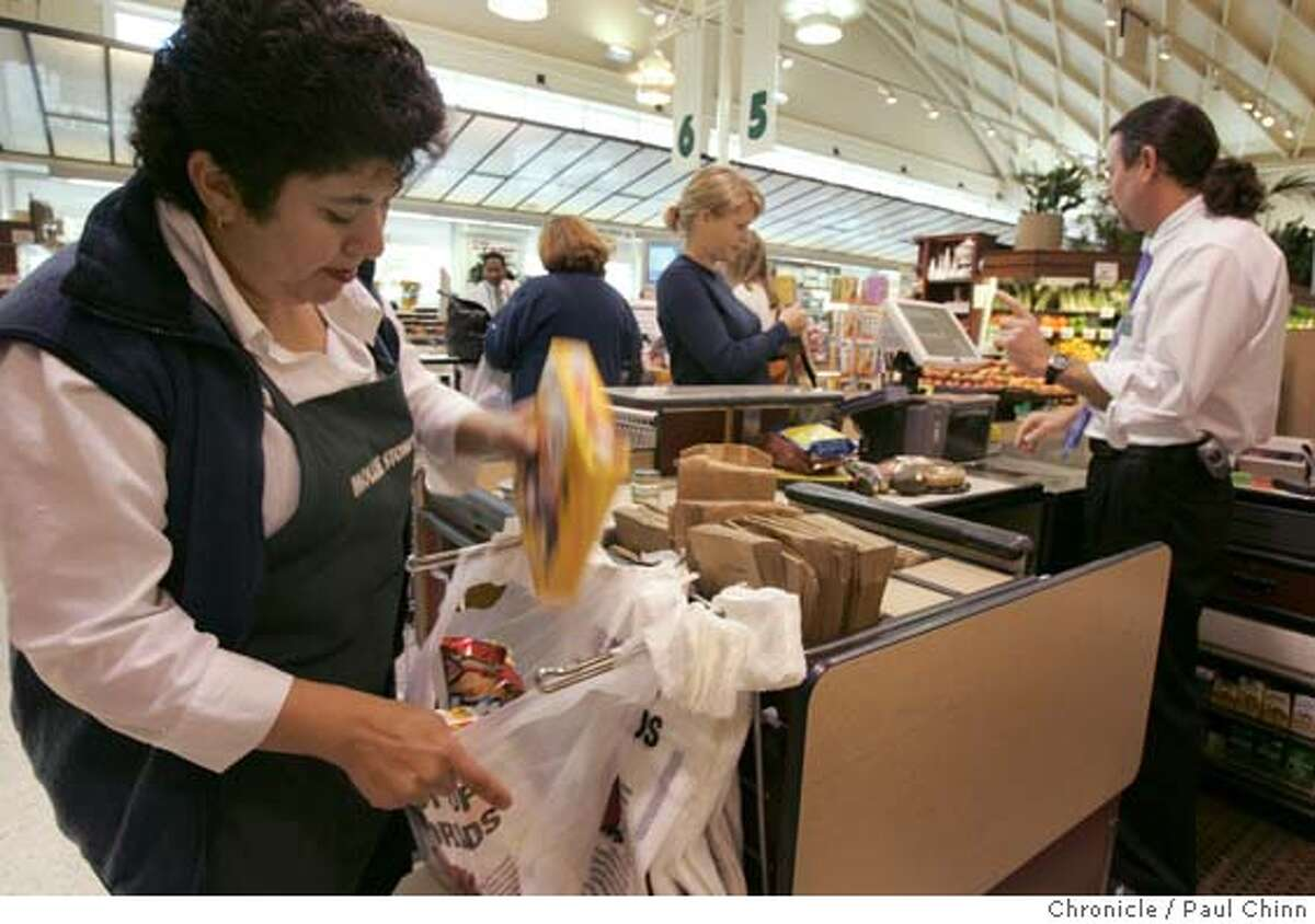 bags04_107_pc.jpg Sonia Castillo bags groceries for a customer at Mollie Stone's on California St. Grocery store shoppers react to the city's new plastic grocery bag restrictions on 11/3/05 in San Francisco, Calif. PAUL CHINN/The Chronicle MANDATORY CREDIT FOR PHOTOG AND S.F. CHRONICLE/ - MAGS OUT