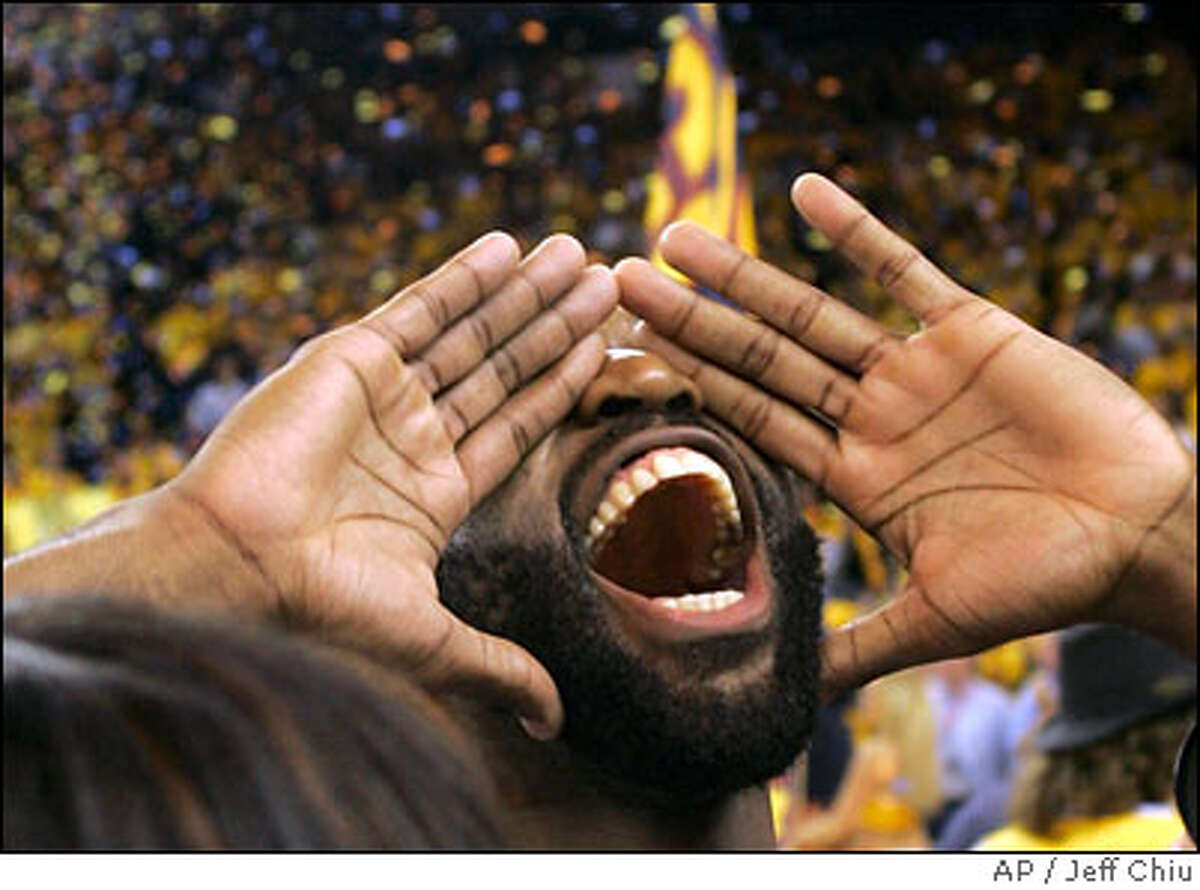 Golden State Warriors' Baron Davis celebrates after the Warriors beat the Dallas Mavericks in an NBA Western Conference first-round basketball playoff game in Oakland, Calif., Thursday, May 3, 2007. The Warriors won 111-86.