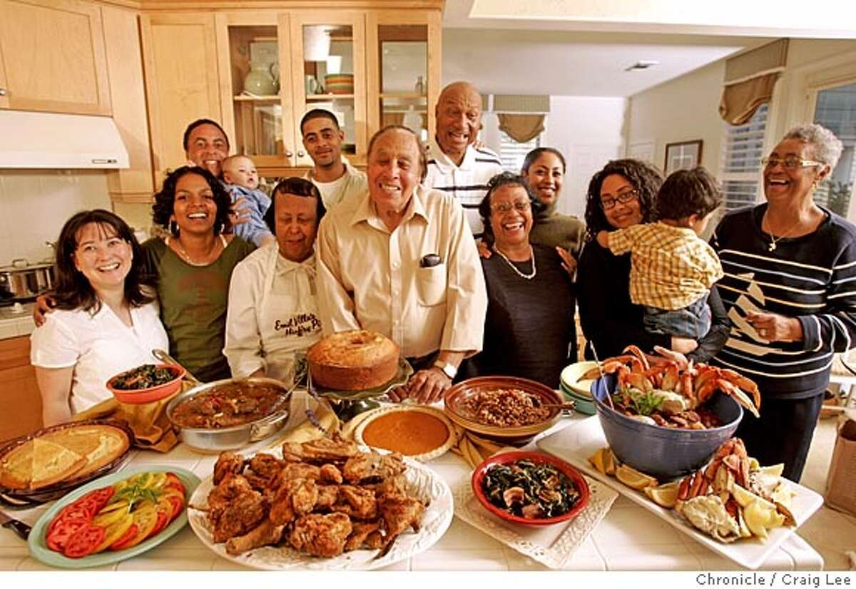 Grandma cooking series. Angelina Muffelletto learns some southern style cooking from Bill and Maudice Gentry, and their son, Gary Gentry. Group photo with the spread of food they had just made. Photo left-right: front row, Lisa Gentry, Angelina Muffelletto, Maudice Gentry, Bill Gentry, Ida Boyette, Bianca Gentry holding her son, Dylan Gentry (20 month-old), and Lula Williams. back row: Gary Gentry holding his son W.D. (William David, 4 month-old), Byron Gentry, Jim Boyette and Brooke Gentry. Gary and Lisa, Jim and Ida are husband and wife. Event on 10/13/05 in Vallejo. Craig Lee / The Chronicle