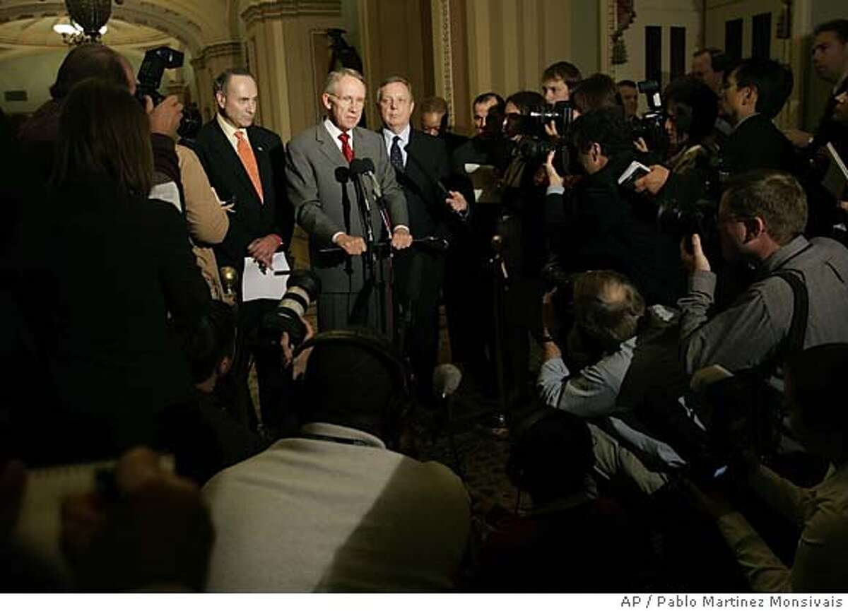 Senate Minority Leader Harry Reid (D-Nev.), center, flanked by Sen. Charles Schumer, D-N.Y., left, and Sen. Richard Durbin, D-Ill., meets with reporters on Capitol Hill, Tuesday, Nov. 1, 2005 after a closed-door Senate session. Democrats forced the Republican-controlled Senate into an unusual closed session Tuesday, questioning intelligence that President Bush used in the run-up to the war in Iraq and accusing Republicans of ignoring the issue.