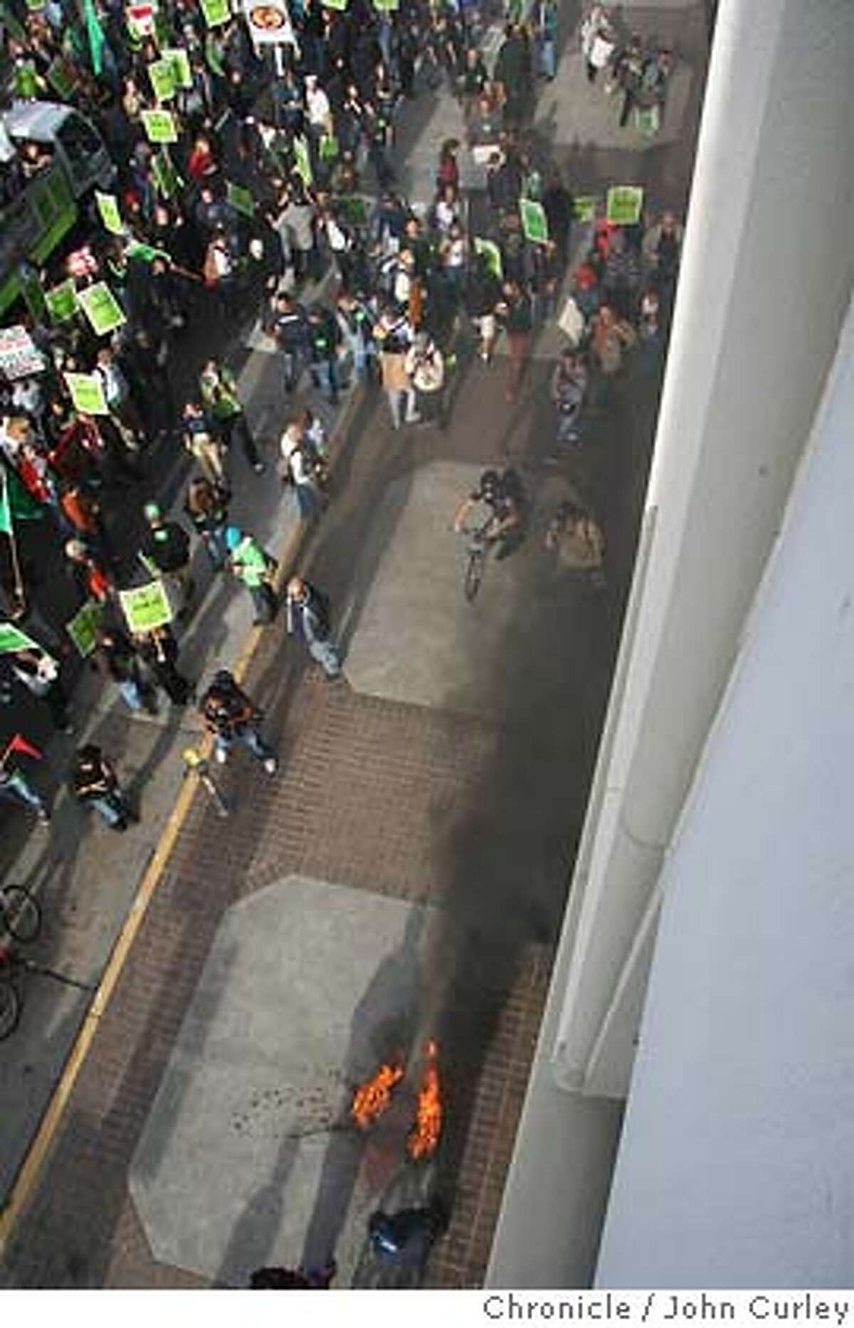 Protestors marching by the offices of the San Francisco Chronicle hurled an incediary device at the building and caused a fire on the sidewalk. Credit: John Curley/Chronicle