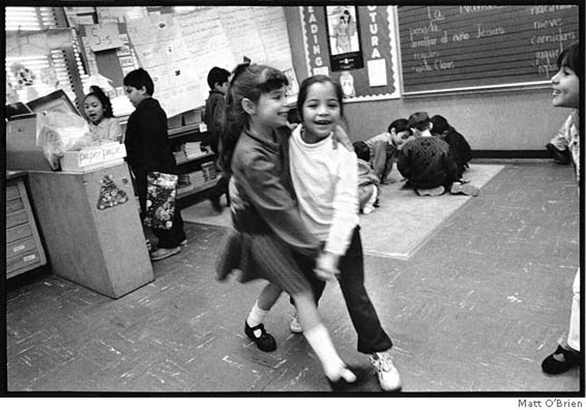 """Image from """"Looking for Hope"""": """"Girls dancing."""" Photo by Matt O'Brien"""