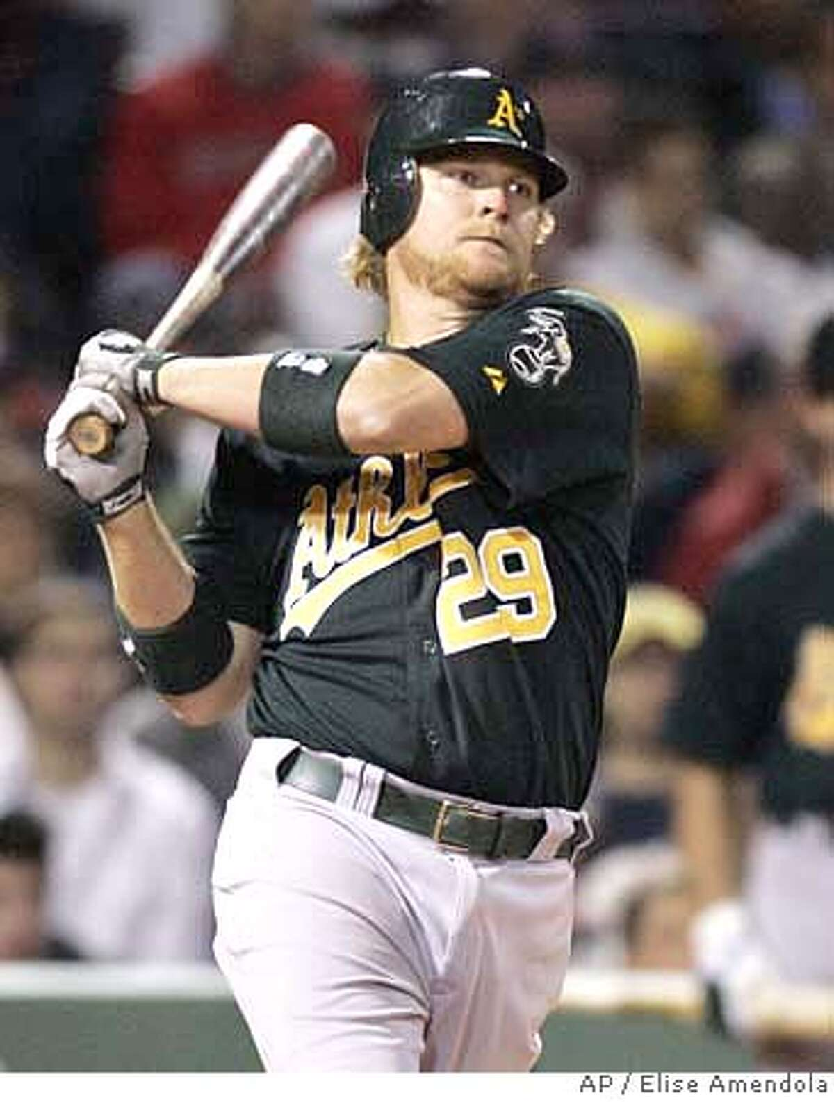 Oakland Athletics' Dan Johnson (29) watches his RBI double scoring Mike Piazza against the Boston Red Sox in the tenth inning of their baseball game at Fenway Park in Boston Tuesday, May 1, 2007. Johnson's hit proved to be the game-winner in their 5-4 victory over the Red Sox. (AP Photo/Elise Amendola)