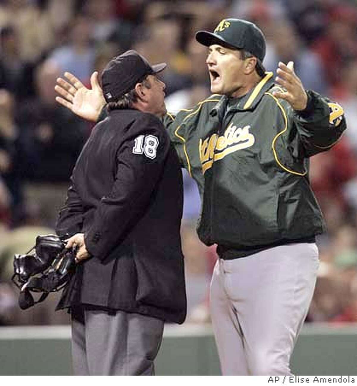 Oakland Athletics manager Bob Geren, right, argues with home plate umpire Charlie Reliford after Eric Chavez struck out to end the fifth inning of their baseball game against the Boston Red Sox at Fenway Park in Boston Tuesday, May 1, 2007. (AP Photo/Elise Amendola)