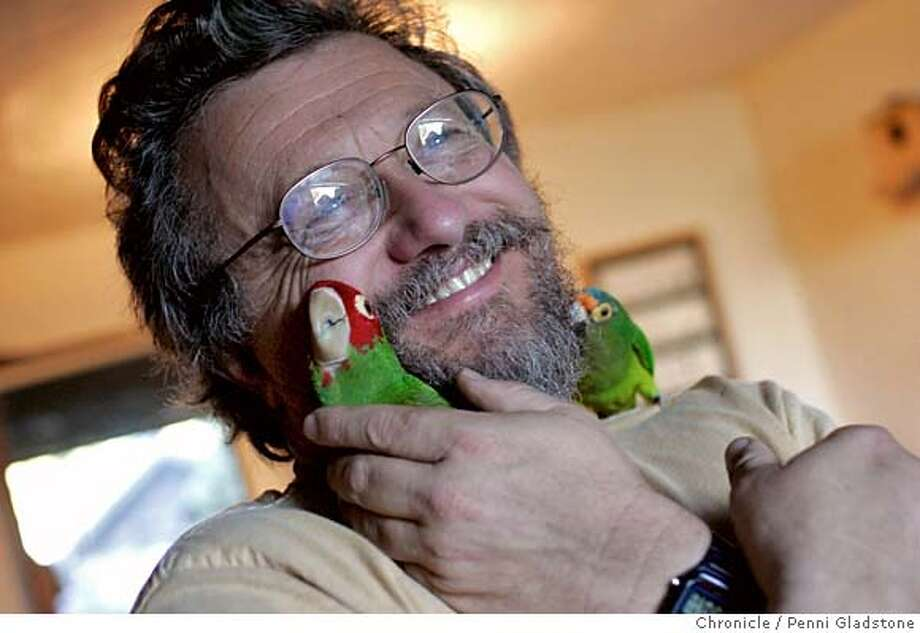 PARROTS_0031_PG.JPG Mark Bittner, subject of a documentry about Parrots that live on Telegraph Hill. Neighbors don't want a tree trimmed too much as the Parrots take naps in it and leave their babies in it who can't fly all day with them. Big Bird at left was a member of the Telegraph Hill flock but is in Mark's care now as it was hurt. The bird on rt is Filbert on rt. San Francisco Chronicle, Penni Gladstone  Photo taken on 10/31/05, in San Francisco, Photo: Penni Gladstone