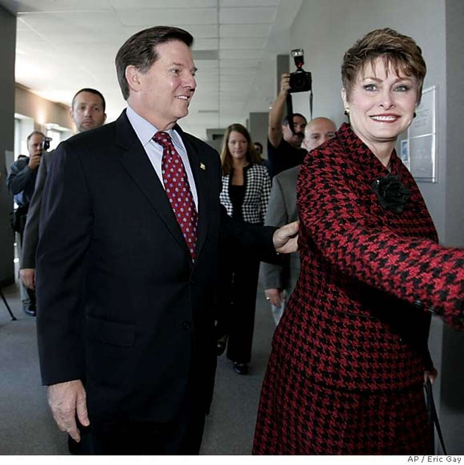 U.S. Rep. Tom DeLay, R-Texas, and his wife Christine arrive at court Tuesday, Nov. 1, 2005, in Austin, Texas. Attorneys defending DeLay are hoping they can convince a judge that Democratic state district Judge Bob Perkins should not oversee his criminal trial. (AP Photo/Eric Gay) Ran on: 11-02-2005  Tom Delay and his wife, Christine, arrive at court in Austin, Texas, where his lawyers sought to move the case to another county. Ran on: 11-02-2005  Tom DeLay and his wife, Christine, arrive at court in Austin, Texas, where his lawyers sought to move the case to another county. Photo: ERIC GAY
