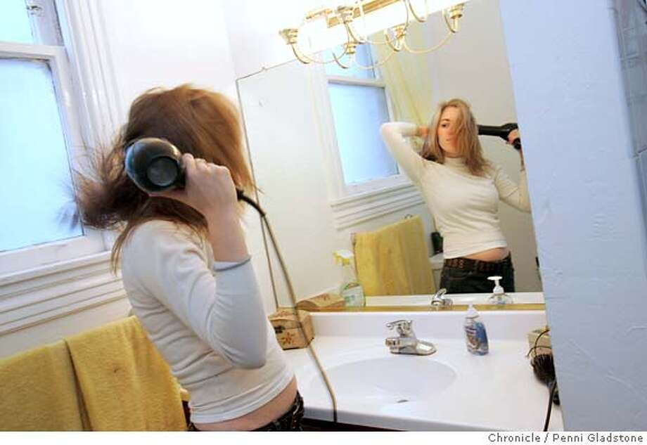 ALICIA_0192_PG.JPG Alicia blow drys her hair in the morning. Loose hair flys around the room San Francisco Chronicle, Penni Gladstone  Photo taken on 10/26/05, in San Francisco, Photo: Penni Gladstone