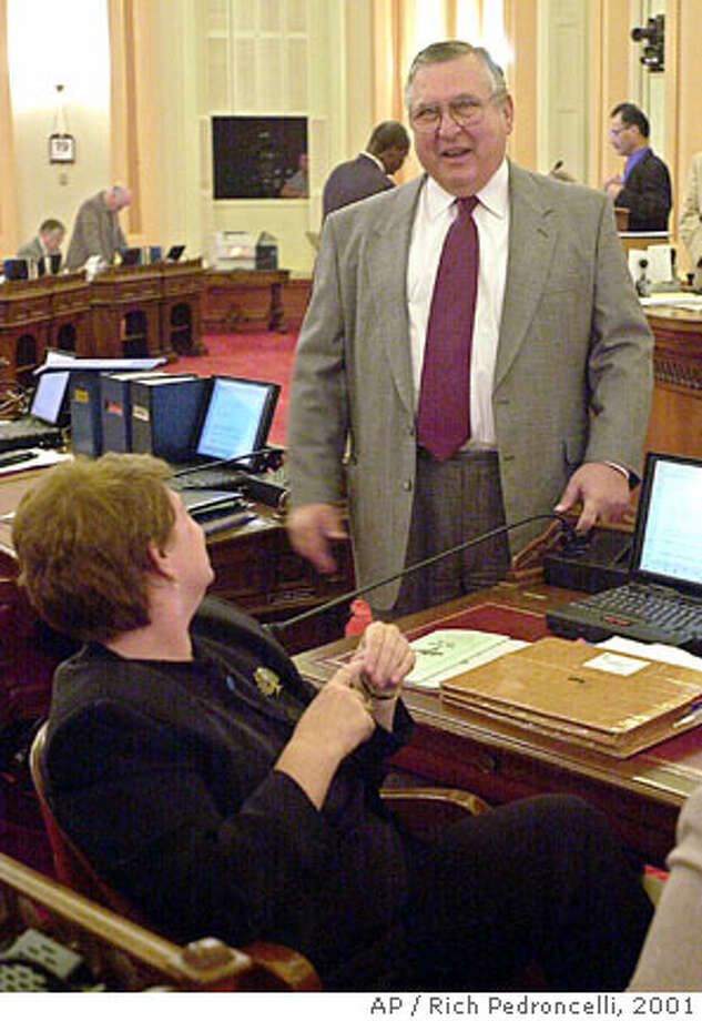 PAPAN-C-19JUL01-MN-AP  Assemblyman Lou Papan, D-Milbrae, right, visiting the state Senate chambers at the Capitol in Sacramento, Calif., Thursday, July 19, 2001, tells state Sen. Sheila Kuehl, D-Santa Monica, left, that in his opinion, Spain is a better place to visit then Italy. Both lawmakers left the state to take vacations overseas. Papan went to Spain for two weeks, missing the Assembly's vote on the state budget, and Kuehl had gone to Italy. Kuehl was called back to California by state Senate President Pro tem John Burton, D-San Francisco, to cast her vote on the budget, which has not been passed by the Senate. (AP Photo/Rich Pedroncelli)  Ran on: 05-08-2006 Ran on: 05-28-2006 Ran on: 04-29-2007  Lou Papan was influential chairman of the powerful state Assembly Rules Committee. Photo: RICH PEDRONCELLI