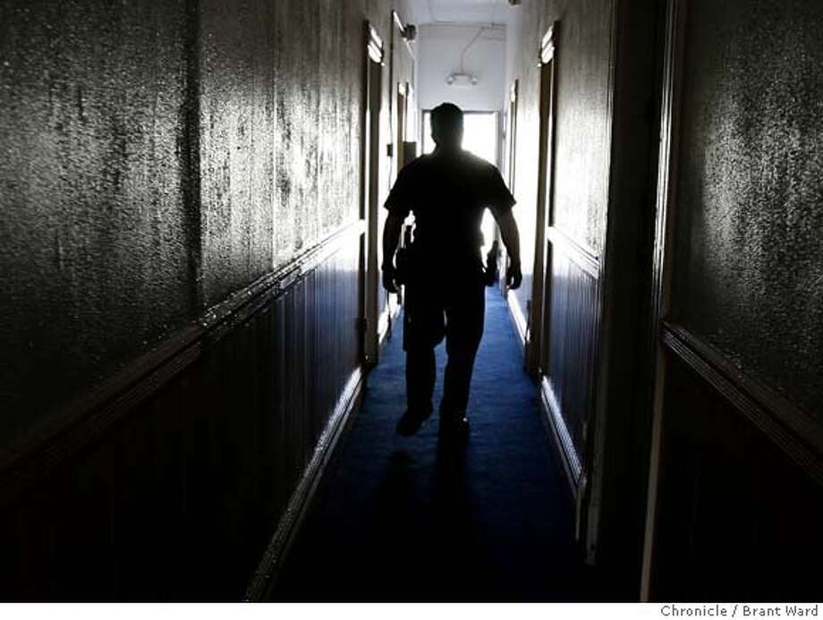 badge_intro118.JPG  SFPD officer Pete Shields walks down a dark hallway of a small Mission district hotel where neighbors have heard someone screaming for help.  The Mission Police Station on San Francisco's Valencia Street is responsible for 2.7 miles of the city. It serves 84,000 residents in the Mission, Noe Valley and Castro districts, from the arty stores in Noe Valley to the gangs on 24th Street.  {Brant Ward/San Francisco Chronicle}4/24/07 Photo: Brant Ward