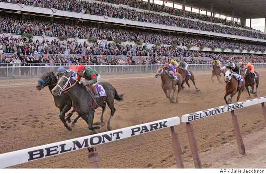 Silver Train (3), with jockey Edgar Prado up, drives to the finish to win the Breeders' Cup Sprint ahead of Taste of Paradise, with jockey Garrett Gomez up, at Belmont Park in Elmont, N.Y., Saturday, Oct. 29, 2005. (AP Photo/Julie Jacobson) Photo: JULIE JACOBSON