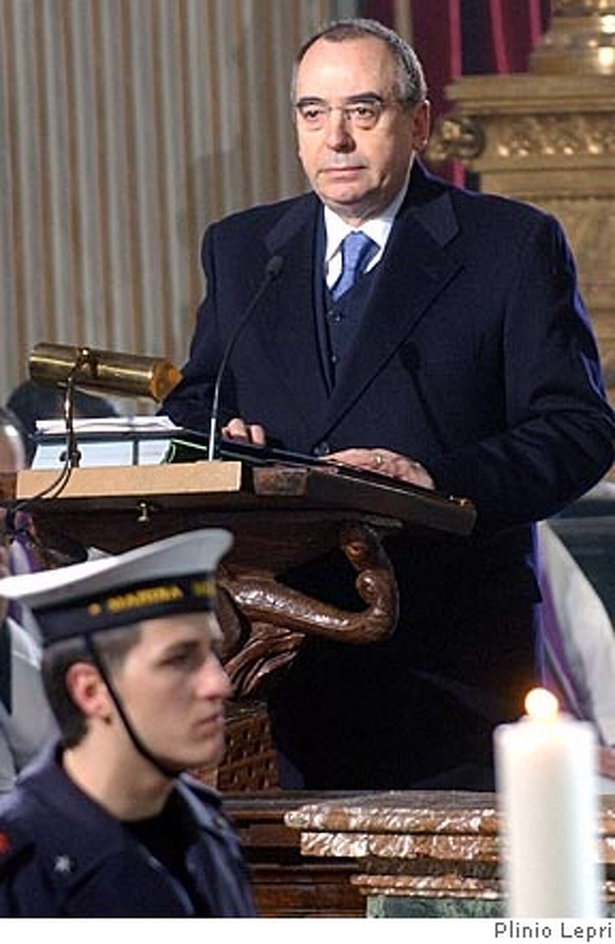 **FILE ** Head of Italian military intelligence, SISMI, Nicolo Pollari speaks at the funeral of late Italian intelligence officer Nicola Calipari in Rome, in this March 7, 2005 file photograph. The head of Italy's military secret services will be questioned by a parliamentary commission on Nov. 3, 2005 over allegations that his organization gave the United States and Britain disputed documents suggesting that Saddam Hussein had been seeking uranium in Africa, officials said Tuesday, Oct. 25, 2005. The documents detailed a purported Iraqi deal to buy 500 tons of uranium yellowcake from Niger. (AP Photo/Plinio Lepri, File) MARCH 7, 2005 FILE PHOTOGRAPH