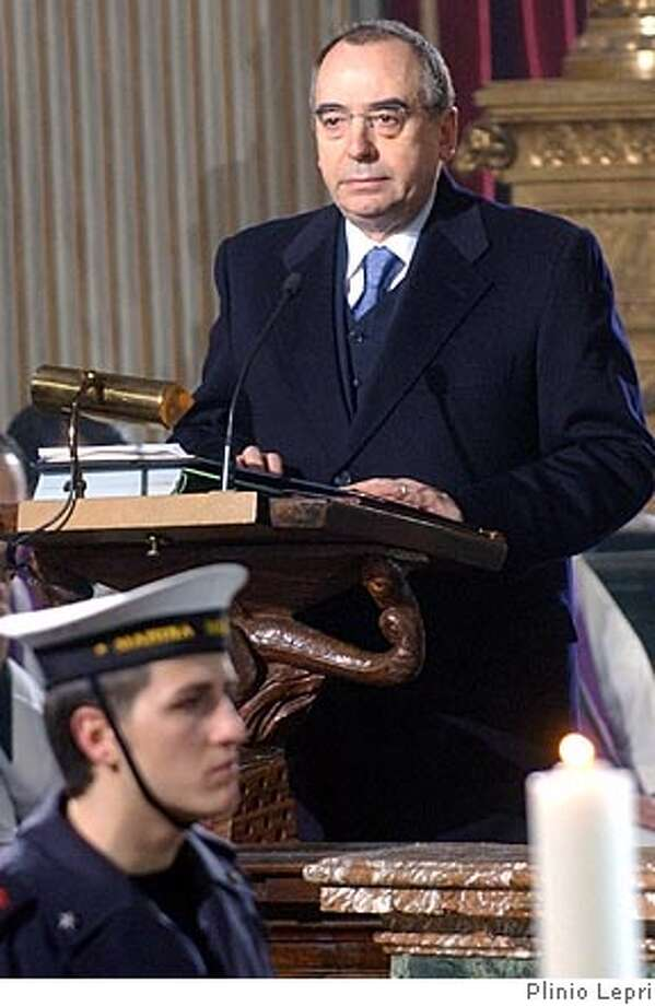 **FILE ** Head of Italian military intelligence, SISMI, Nicolo Pollari speaks at the funeral of late Italian intelligence officer Nicola Calipari in Rome, in this March 7, 2005 file photograph. The head of Italy's military secret services will be questioned by a parliamentary commission on Nov. 3, 2005 over allegations that his organization gave the United States and Britain disputed documents suggesting that Saddam Hussein had been seeking uranium in Africa, officials said Tuesday, Oct. 25, 2005. The documents detailed a purported Iraqi deal to buy 500 tons of uranium yellowcake from Niger. (AP Photo/Plinio Lepri, File) MARCH 7, 2005 FILE PHOTOGRAPH Photo: PLINIO LEPRI