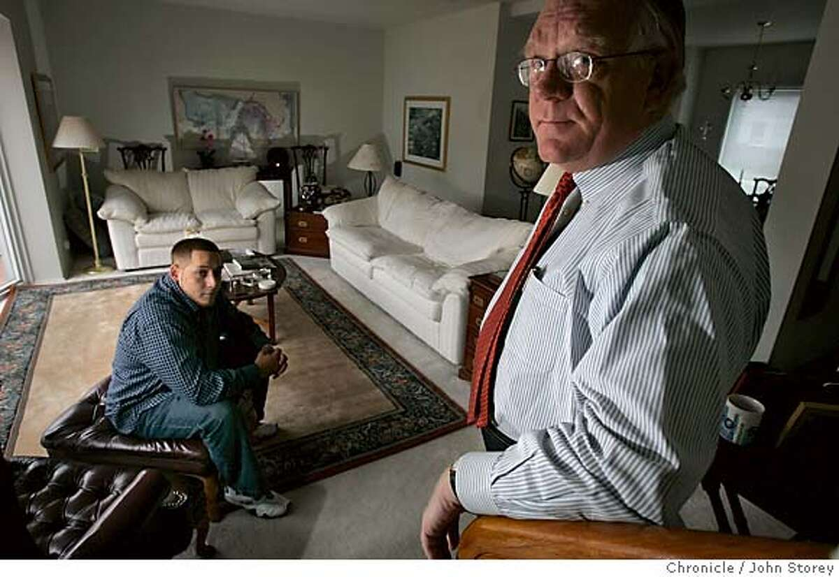 Patrick Hines at his home in San Francisco with some pictures having his son Kevin Hines in the background. Kevin jumped from the Golden Gate Bridge and lived. John Storey San Francisco Event on 9/15/05