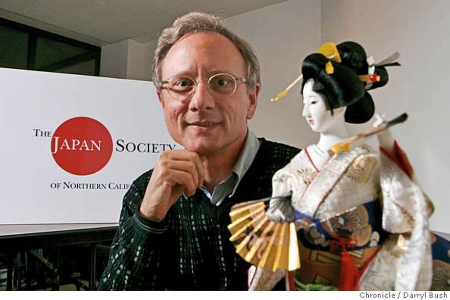japansociety_0031_db.jpg  Christopher J. Sigur, president of The Japan Society of Northern California, in their offices showing a Japanese doll and their logo in the background.  Event on 10/27/05 in San Francisco.  Darryl Bush / The Chronicle MANDATORY CREDIT FOR PHOTOG AND SF CHRONICLE/ -MAGS OUT Photo: Darryl Bush