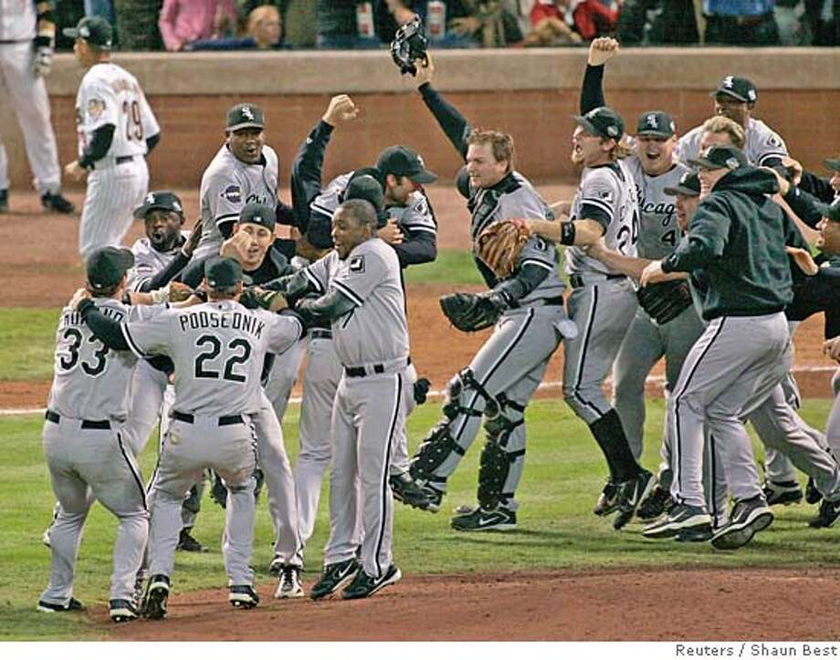 Chicago White Sox players celebrate winning the baseball championship over the Houston Astros in Game 4 of Major League Baseball's World Series in Houston, October 26, 2005. Chicago defeated Houston 1-0 to win the series in four straight games. REUTERS/Shaun Best 0 Photo: SHAUN BEST