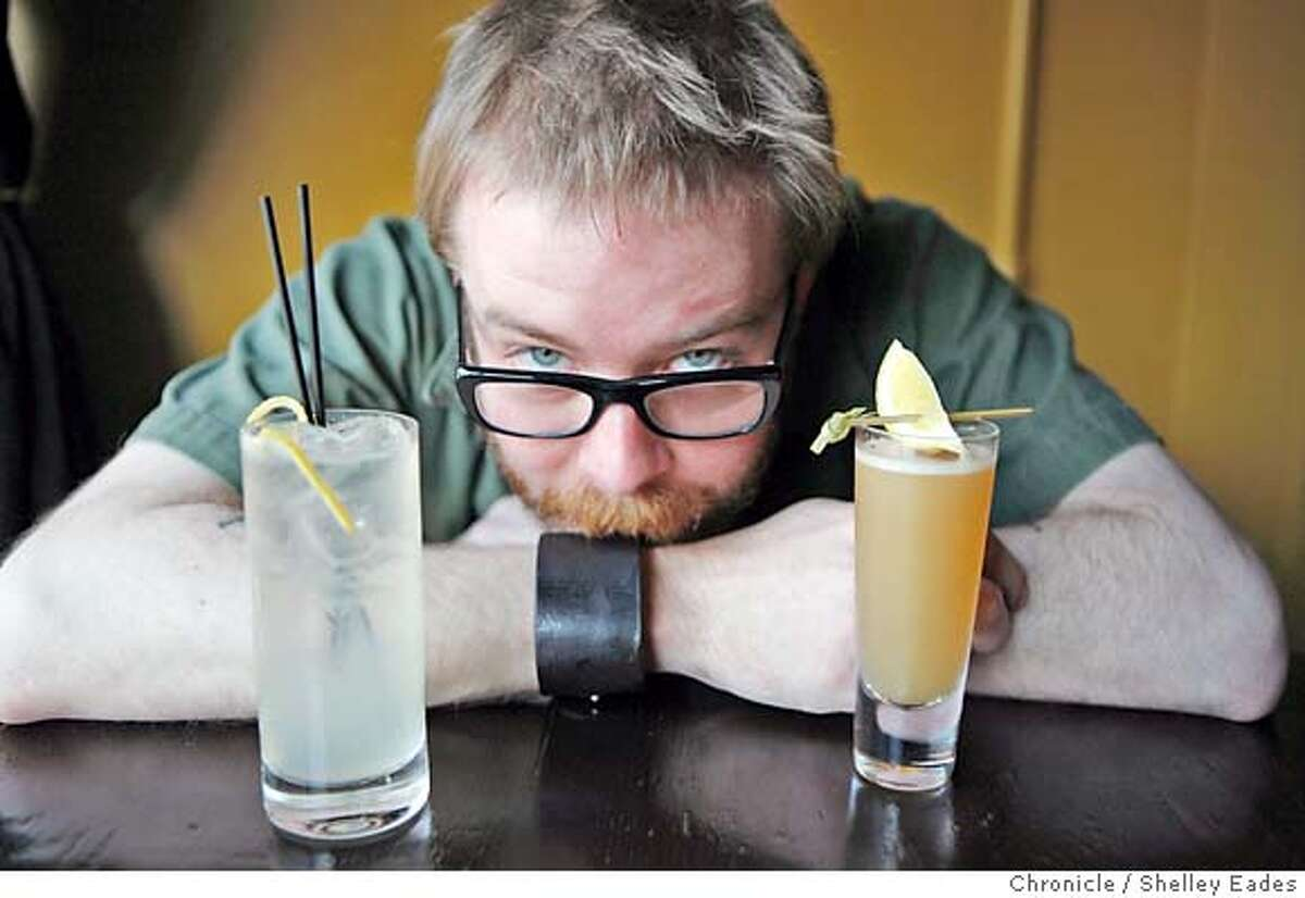 Bartender Daniel Hyatt invented the Mediterranean Homesick Blues (the clear cocktail with a twist of lemon) and the Mellow Yellow (small and yellow), popular drinks at The Alembic on Haight Street. Shelley Eades/The Chronicle No sales/mandatory credit photog Mags out.