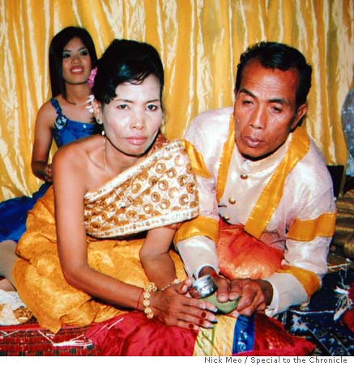 Cambodian couples forcibly married by the Khmer Rouge have married again three decades on, this time by a traditional Khmer ceremony. Picture shows Mrs. Prum Son, 50, and her husband Uk Huy, 55, in a wedding day photo taken at their second wedding in December in their village of Kbal Sen. They were strangers when they were married at a spartan ceremony in 1977 during the regime's rule. If they had refused they would have been executed. But their marriage has lasted nearly thirty years and they have four children. Nick Meo/Special to The Chronicle NO MAGS, NO SALES, NO TV