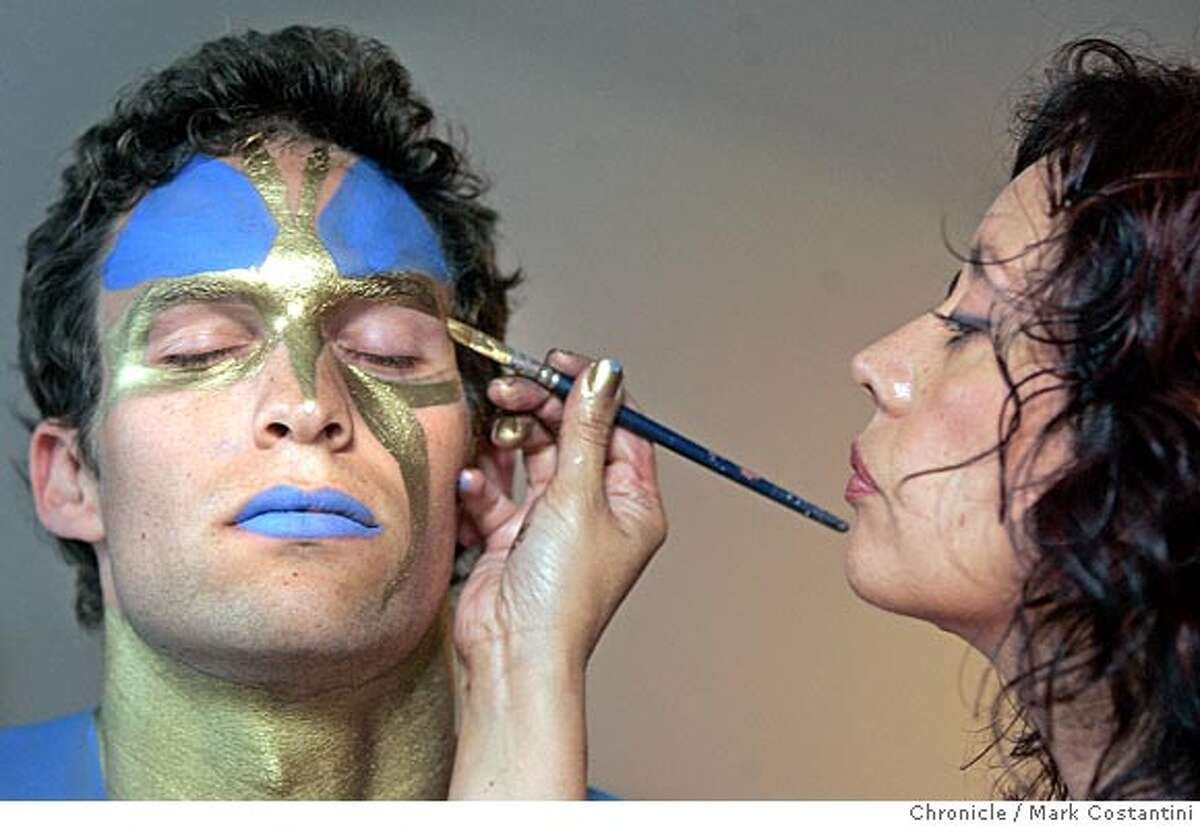 Tenes paints details on Jeff's face. Face painter Diana Tenes who lives in Walnut Creek, grew up in San Jose and studied in San Francisco. She's worked in theater and film, teaches workshops and practices her art at events throughout the Bay Area. Her web site is imakefaces.com. Here she is working on a model to do an entire body paint session where she'll tranform the person. This is our halloween story, so we'd probably run about 4 photos of the work in progress as lead. We'd also need a shot of her on the cover, doing her thing. PHOTO: MARK COSTANTINI/S.F. CHRONICLE