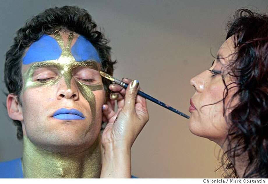 Tenes paints details on Jeff's face.  Face painter Diana Tenes who lives in Walnut Creek, grew up in San Jose and studied in San Francisco. She's worked in theater and film, teaches workshops and practices her art at events throughout the Bay Area. Her web site is imakefaces.com. Here she is working on a model to do an entire body paint session where she'll tranform the person. This is our halloween story, so we'd probably run about 4 photos of the work in progress as lead. We'd also need a shot of her on the cover, doing her thing. PHOTO: MARK COSTANTINI/S.F. CHRONICLE Photo: Mark Costantini