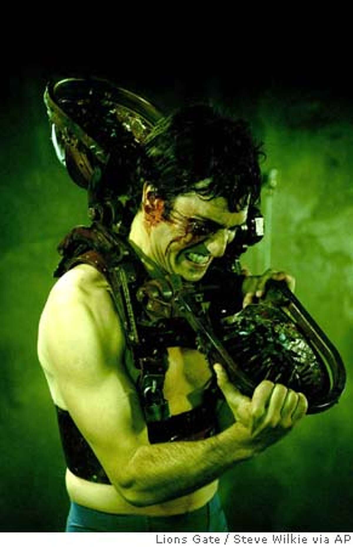 In this photo provided by Lions Gate, Michael (Noam Jenkins) struggles with Jigsaw's Venus Flytrap from