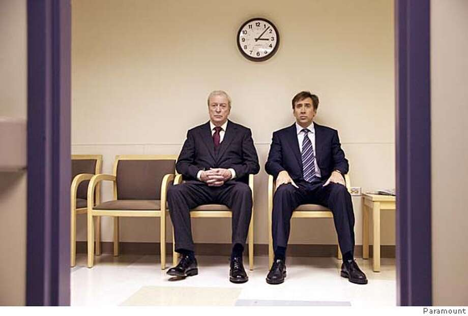 """Michael Caine and Nicolas Cage in """"The Weather Man"""" 2005 Ran on: 10-30-2005  Michael Caine (left) and Nicolas Cage in &quo;The Weather Man&quo;: Forty-two directors wanted to make the picture. Photo: Paramount"""