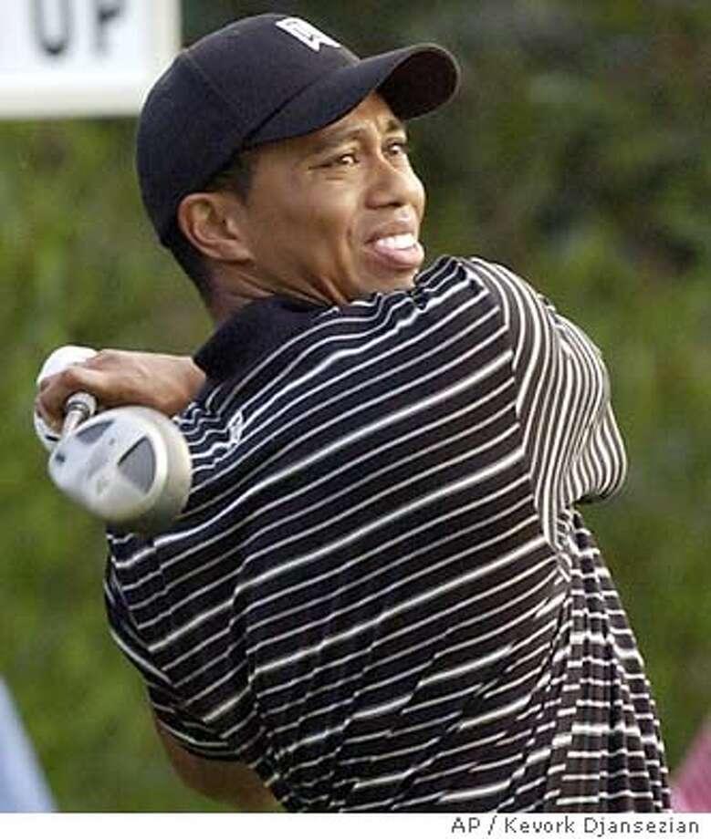7/31/2003 | B/W | 3star | 22p8 x 4 5/8 inches | C2 | Sports | chris 6171 | Tiger Photo: KEVORK DJANEZIAN