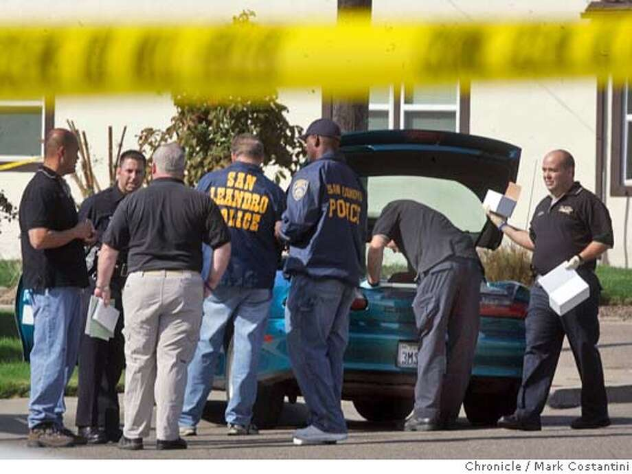 shooting_060_mc.jpg  Scene of apparent murder-suicide in San Leandro near 137th Ave. and Wake. The car in the picture, seen through crime scene tape, is apparently where the shootings transpired. PHOTO: Mark Costantini/San Francisco Chronicle MANDATORY CREDIT FOR PHOTOG AND SF CHRONICLE/ -MAGS OUT Photo: Mark Costantini
