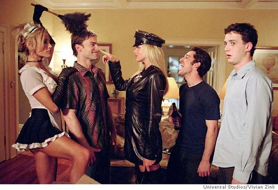 "Cast members (L-R) Amanda Swisten, Seann William Scott, Nikki Ziering, Thomas Ian Nicholas and Eddie Kaye Thomas are shown at a bachelor party in this scene from the new comedy film ""American Wedding"", the third film in the ""American Pie"" film series, in this undated publicity photograph. The film opens August 1, 2003 in the United States. REUTERS/Vivian Zink/Universal Studios/Handout Photo: HO"