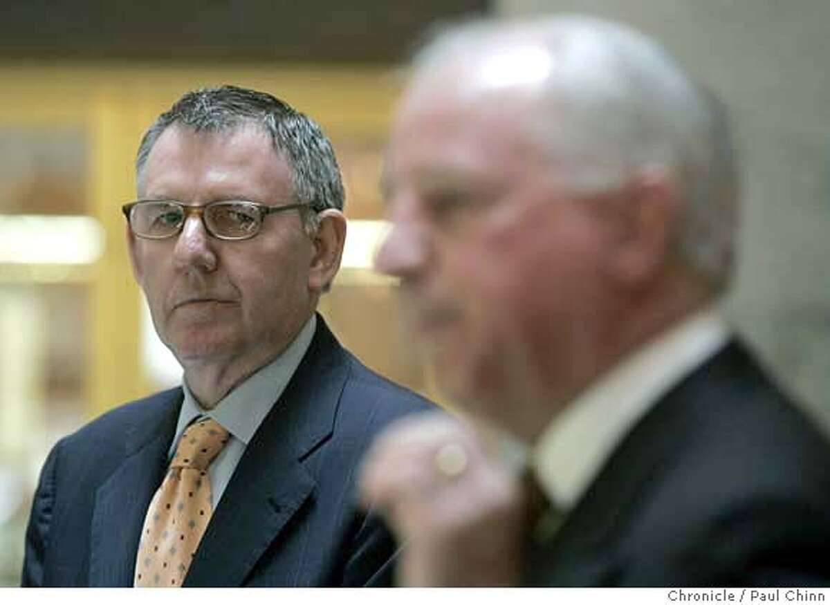 Clint Reilly (left) listens to his attorney Joseph Alioto announce a settlement in Reilly's lawsuit against the Hearst Corporation and Media News Group at a news conference in San Francisco, Calif. on Wednesday, April 25, 2007. PAUL CHINN/The Chronicle **Clint Reilly, Joseph Alioto MANDATORY CREDIT FOR PHOTOGRAPHER AND S.F. CHRONICLE/NO SALES - MAGS OUT