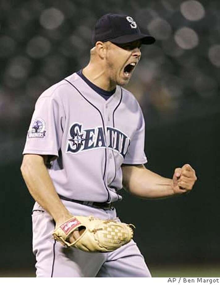 Seattle Mariners' Jarrod Washburn reacts as the final out is made in the Mariners' 2-0 win over the Oakland Athletics in a baseball game Wednesday, April 25, 2007, in Oakland, Calif. (AP Photo/Ben Margot) Photo: Ben Margot