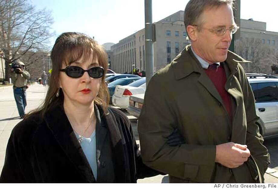 Deborah Jean Palfrey of Vallejo, Calif., left, and her attorney Montgomery Blair Sibley, leave the federal court in Washington, Friday, March 9, 2007 after Palfrey's arraignment on federal racketeering charges, Friday March 9, 2007 in Washington. (AP Photo/Chris Greenberg)  Ran on: 04-01-2007  Jeane Palfrey, who owned an escort service, has been charged under federal racketeering law. Photo: CHRIS GREENBERG