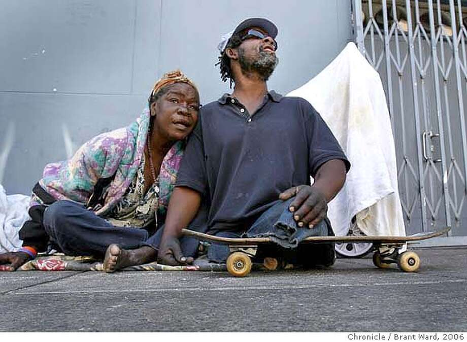 "skateboard106.JPG  Linda Thomas, left, and Monty Holmes, aka ""Skateboard,"" right, pictured in the Tenderloin in 2006. Skateboard, a homeless man who often lived on the streets of the Tenderloin district of San Francisco, lost both his legs earlier in his life and got around on a skateboard. {Brant Ward/San Francisco Chronicle}7/13/06 Ran on: 04-25-2007 Ran on: 04-25-2007 Ran on: 04-25-2007 Ran on: 04-25-2007 Photo: Brant Ward"