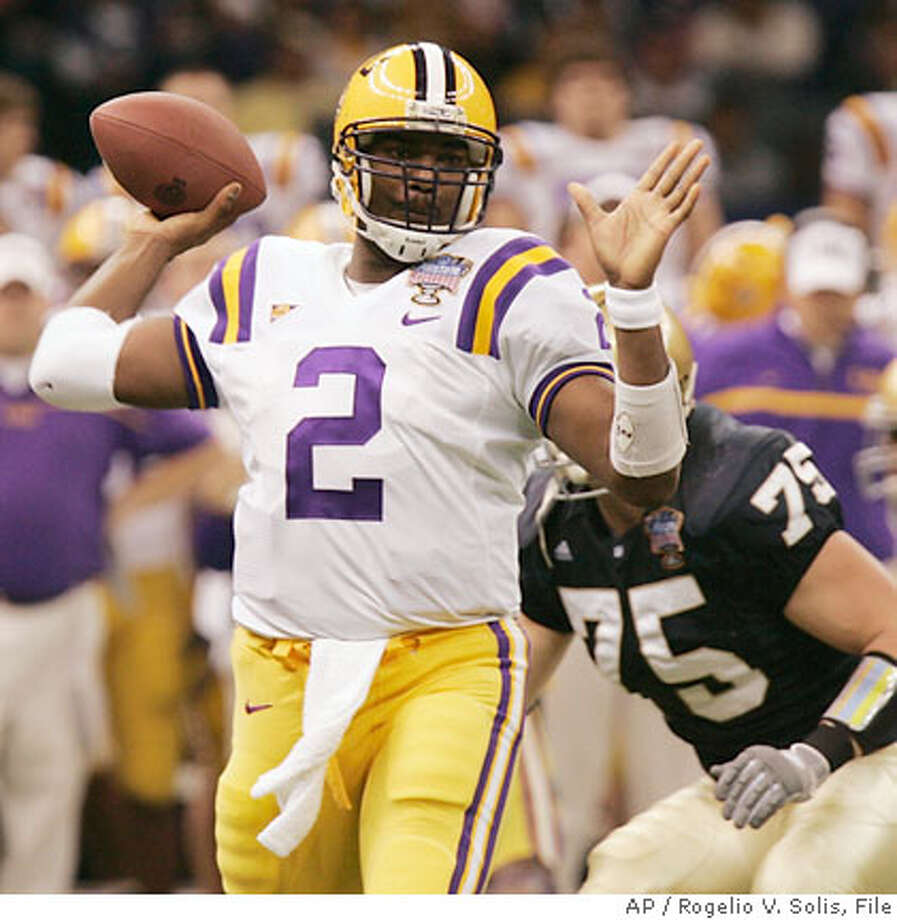 LSU quarterback JaMarcus Russell (2) passes as Notre Dame's Chris Frome (75) comes in from behind during the first half of the Sugar Bowl football game at the Louisiana Superdome in New Orleans Wednesday, Jan. 3, 2007. (AP Photo/Rogelio V. Solis) Photo: Rogelio V. Solis
