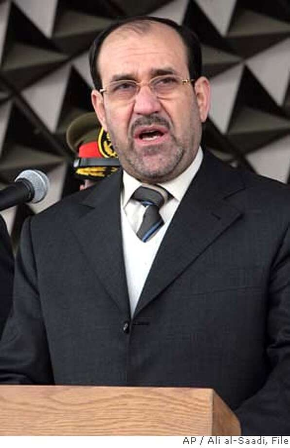 **FILE** Iraq's prime minister Nouri Al-Maliki delivers a speech during celebrations of the Iraqi Army Day at the Tomb of the Unknown Soldier in Baghdad, Iraq, in a Saturday, Jan. 6, 2007 photo. President Bush calls a crackdown on Shiite militias critical to success in Iraq but Prime Minister Nouri al-Maliki has been noticeably silent. Supporting Bush's plan would mean attacking the Shiite radicals who have helped expand his Shiite dominance over much of Iraq. (AP Photo/ Ali al-Saadi, File) JAN. 6, 2007 FILE PHOTO. Photo: ALI AL-SAADI