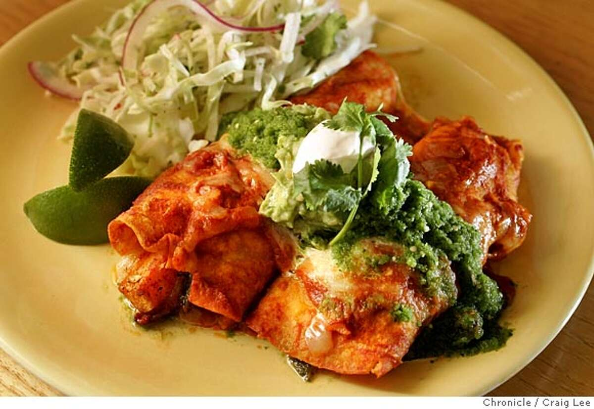 Seasonal Cook column on how to use butternut squash. Chef Tracy Bates, the head cook at the Oxbow School, a private art school in Napa. Tracy Bates is preparing her recipe for butternut squash enchiladas. Photo of a finished plate of the butternut squash enchiladas. Event on 10/19/05 in Napa. Craig Lee / The Chronicle