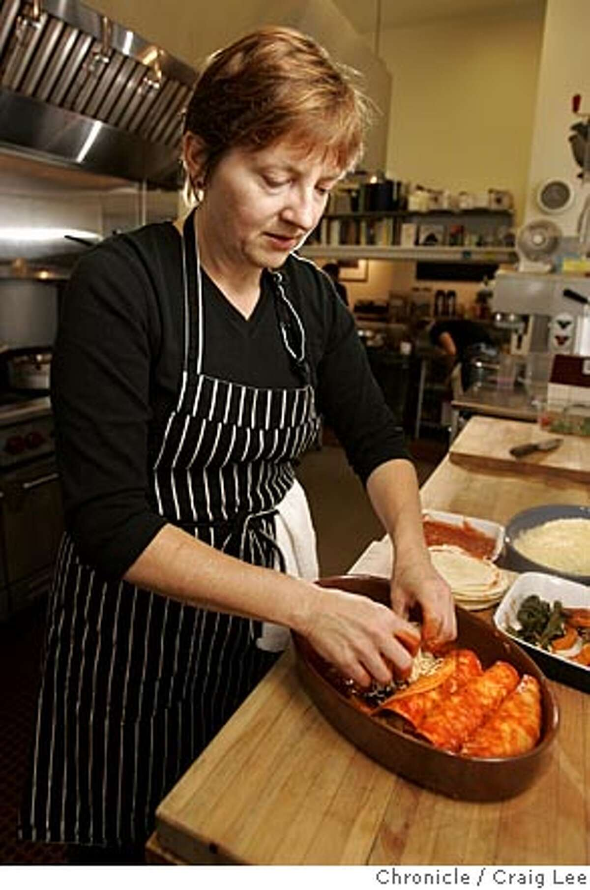 Seasonal Cook column on how to use butternut squash. Chef Tracy Bates, the head cook at the Oxbow School, a private art school in Napa. Tracy Bates is preparing her recipe for butternut squash enchiladas. Event on 10/19/05 in Napa. Craig Lee / The Chronicle