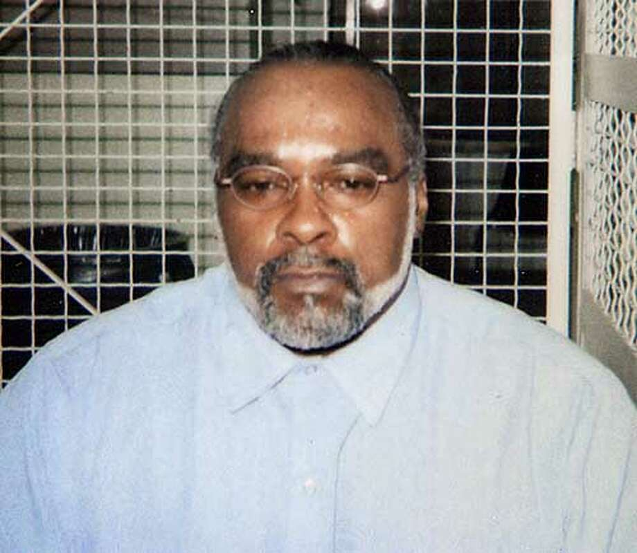 "** FILE **This undated photo provided by the family of Stanley ""Tookie"" Williams, shows Williams in the visiting area of San Quentin State Prison in California. A judge signed a death warrant Monday, Oct. 23. 2005, and set December 13, 2005, as the date Williams will be executed, for four murders he committed in 1979. (AP Photo/Courtesy of Williams Family) ** ** Ran on: 10-25-2005  Stanley &quo;Tookie&quo; Williams was convicted in the murders of four people in the Los Angeles area. Photo: AP"