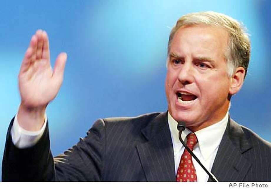 Vermont Gov. Howard Dean talks to delegates and guests during the Presidential Candidates Forum at the NAACP Convention Monday, July 14, 2003 in Miami Beach, Fla. (AP Photo/Alan Diaz) Photo: ALAN DIAZ
