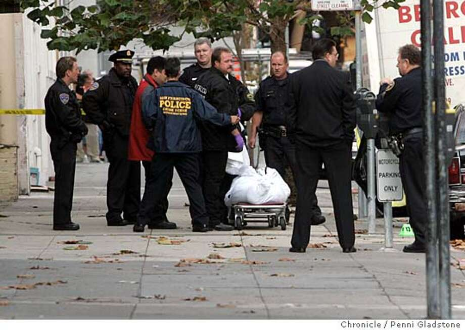 MURDER_0084_PG.JPG Coroner on scene. Body of shooter in bag after he killed himself.  MURDER at Jackson and Polk. next to Lombardi's sporting goods. A person shot another then shot himself. San Francisco Chronicle, Penni Gladstone  Photo taken on 10/27/05, in San Francisco, Photo: Penni Gladstone