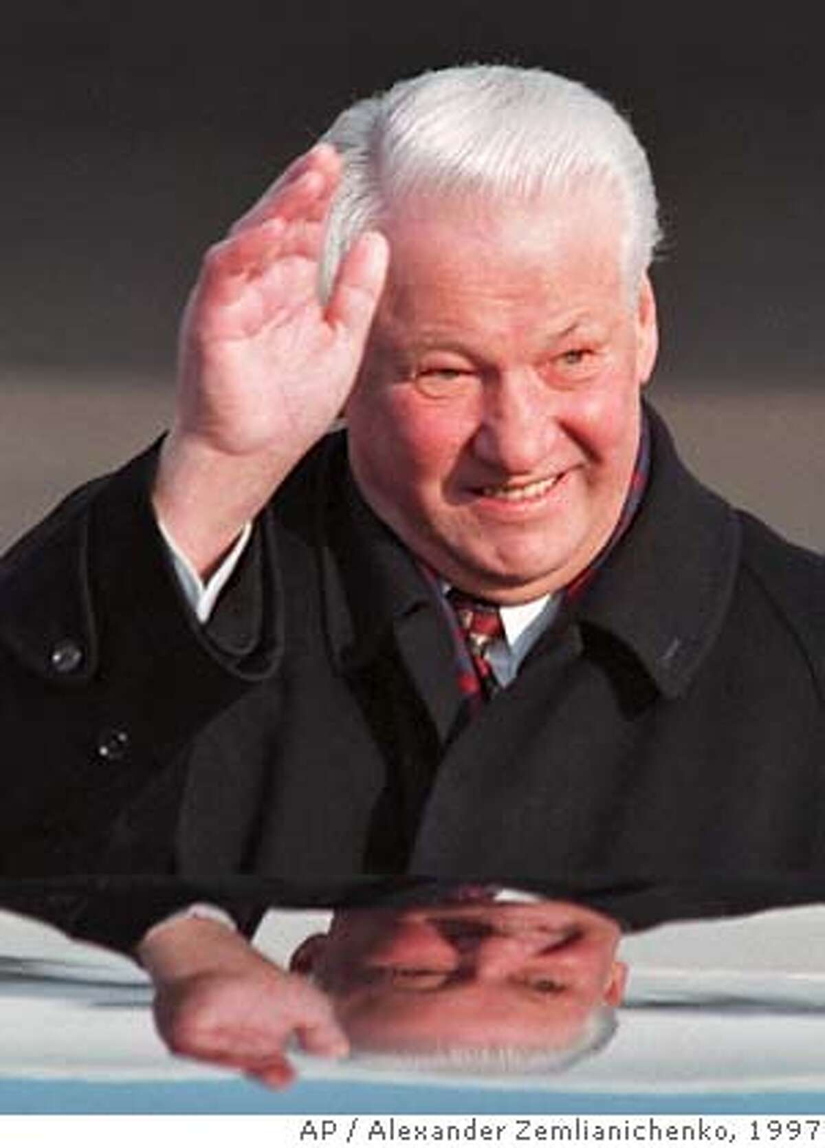 ** FILE ** Russian President Boris Yeltsin waves as he arrives at Helsinki airport in this Thursday, March 20, 1997 file photo. Yeltsin, who engineered the final collapse of the Soviet Union and pushed Russia to embrace democracy and a market economy, has died, a Kremlin official said Monday, April 23, 2007. He was 76. (AP Photo/Alexander Zemlianichenko) MARCH 20, 1997 FILE PHOTO