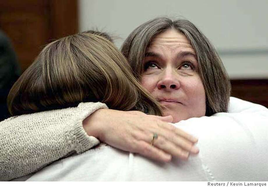 "Mary Tillman, mother of former football star Pat Tillman, looks up as she receives a hug after testifying about Pat Tillman's death in battle at a hearing titled ""Misleading information from the battlefield"" held by the House Oversight and Government Reform Committee on Capitol Hill in Washington April 24, 2007. Tillman is being hugged by another parent at the hearings, Liz Sweet(back to camera), whose son Thomas John Sweet was killed in 2003. Pat Tillman was killed by friendly fire in Afghanistan in 2004. REUTERS/Kevin Lamarque (UNITED STATES) 0 Photo: KEVIN LAMARQUE"